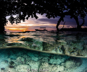Sunset in Misool, Indonesia by Nick Blake 
